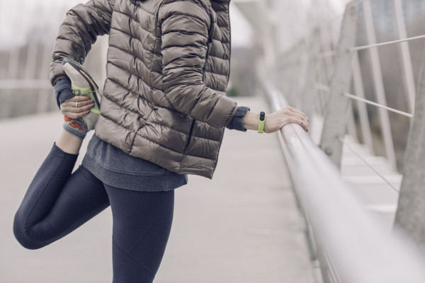Person running, jogging and stretching