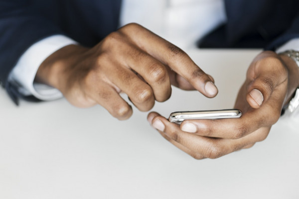 Hands holding a phone