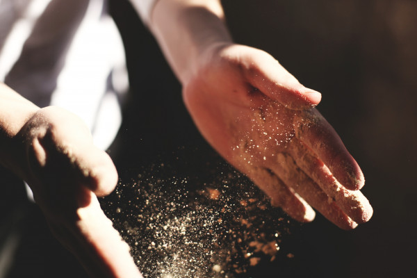 Dust blowing from a pair of hands
