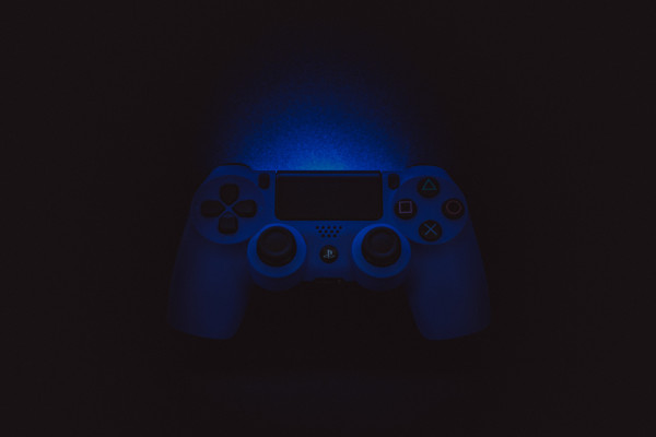 A playstation controller in the dark