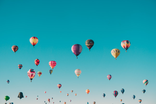 Hot air balloons in a blue sky