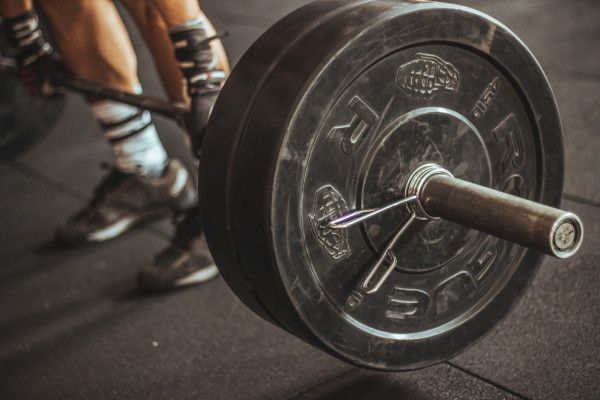 This is a picture of a person lifting a heavy weight bar.