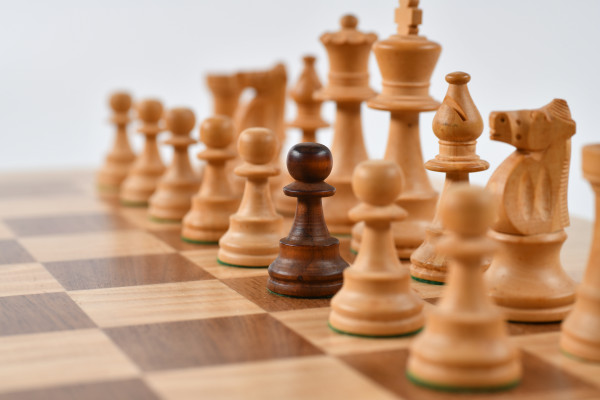White chess set with black chess piece