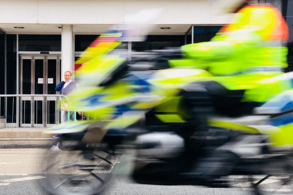 Police motorcyclist in hi-vis jacket