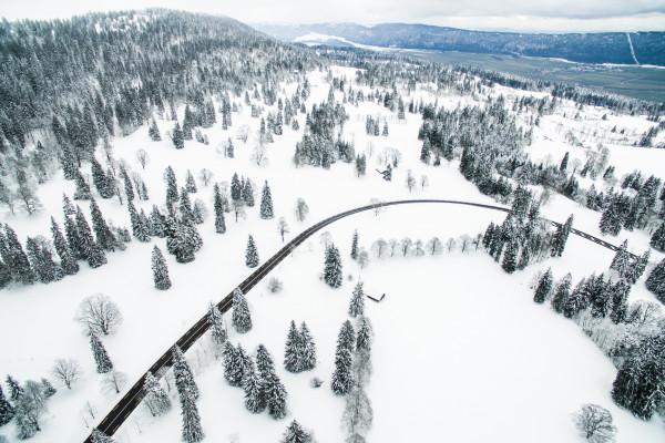 A road running through snowy mountains