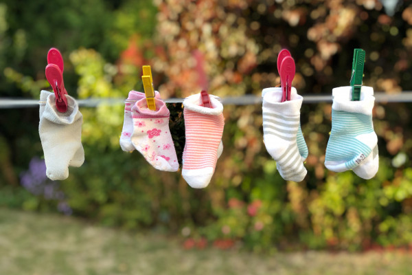 Colourful socks hanging on a washing line