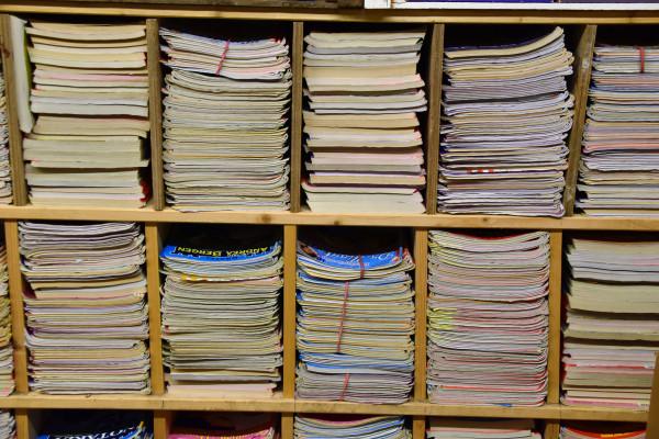 Journals on a bookshelf