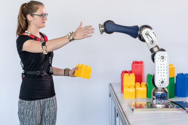 Human interacting with robot arm