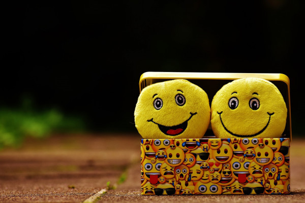 An image of two cartoon smiley faces in a box