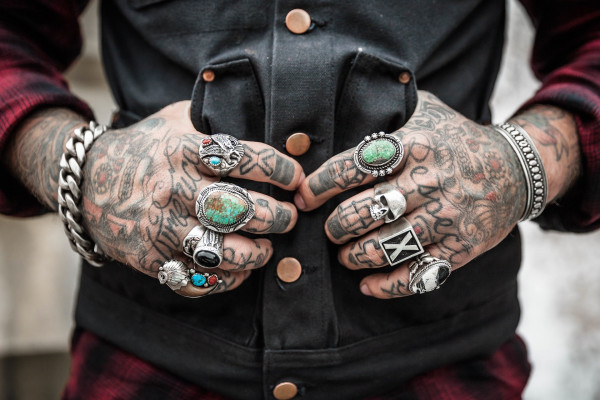 Hands covered in tattoos