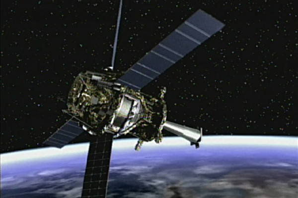 Artist concept of Gravity Probe B spacecraft in orbit around the Earth.