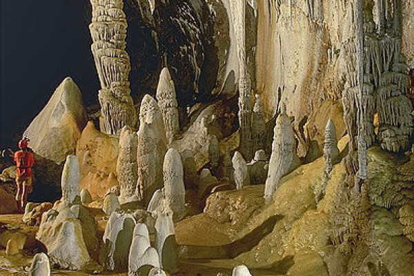 Stalagmites, stalactites, and draperies by a pool in Lechuguilla Cave, New Mexico, USA.