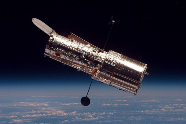 The Hubble Space Telescope (HTS) begins its separation from Space Shuttle Discovery following its release on mission STS-82.