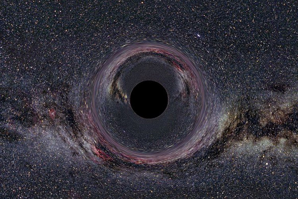 A simulated Black Hole of ten solar masses as seen from a distance of 600km with the Milky Way in the background (horizontal camera opening angle: 90°)