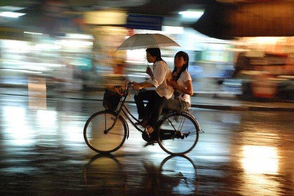 Cycling through Hanoi in the rain.