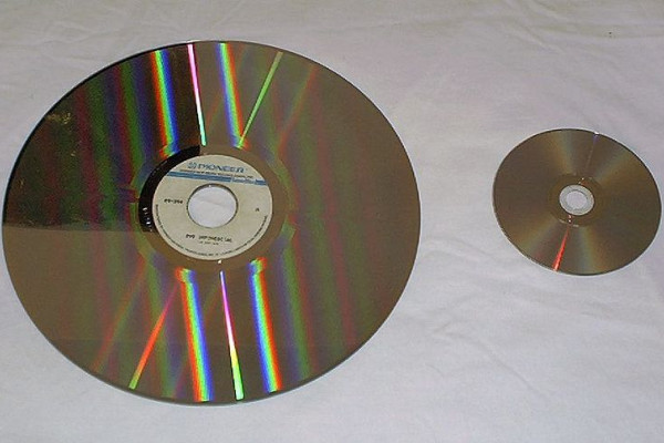 A laserdisc (left) compared with a DVD (right).