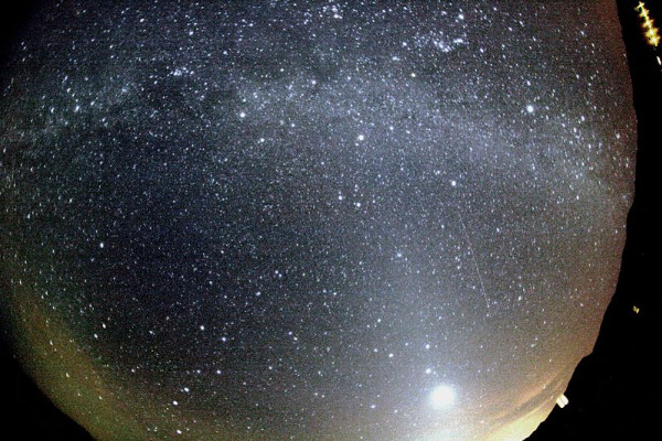 Orionid meteor striking the sky below Milky Way and to the right of Venus. Zodiacal light is also seen at the image. The trail of the meteor appears slightly curved due to edge distortion in the lens.