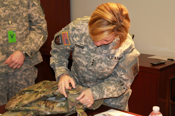 Army Surgeon General dons new female body armor.