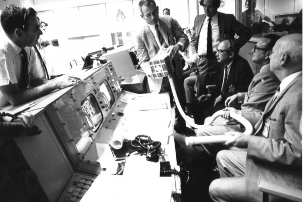 Deke Slayton (check jacket) shows the adapter devised to make use of square Command Module lithium hydroxide canisters to remove excess carbon dioxide from the Apollo 13 LM cabin. As detailed in Lost Moon by Jim Lovell and Jeffrey Kluger, the adapter...