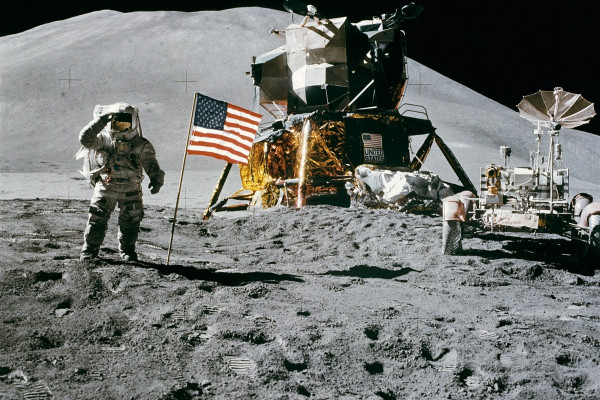 Apollo 15 Lunar Module Pilot James Irwin salutes the U.S. flag. Astronaut James B. Irwin, lunar module pilot, gives a military salute while standing beside the deployed U.S. flag during the Apollo 15 lunar surface extravehicular activity (EVA) at the...