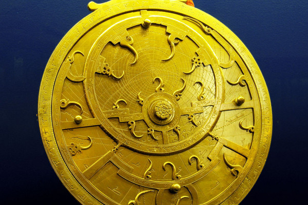 An 18th Century Persian astrolabe - maker unknown. The points of the curved spikes on the front ''rete'' plate, mark the positions of the brightest stars. The name of each star being labeled at the base of each spike. The back plate, or ''mater'' is...