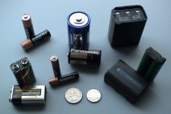 Various batteries: two 9-volt, two \AAA\, two \AA\, and one each of \C\, \D\, a cordless phone battery, a camcorder battery, a 2-meter handheld ham radio battery, and a button battery.