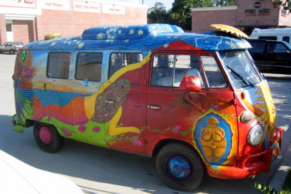 A VW Combi decorated by hippies.