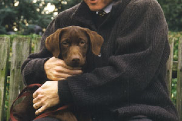 Persident Bill Clinton getting acquainted with Buddy on the South Lawn, December 5, 1997.
