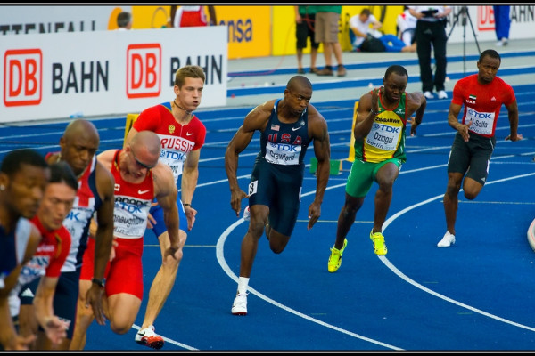 Athletes turning the first bend of the 200 m