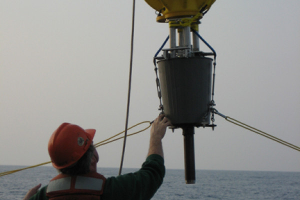 Hauling a DOV back on deck, with buoyancy control in the yellow housing, and sampling equipment underneath.