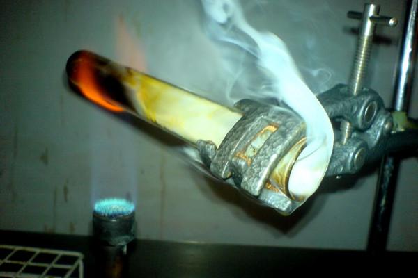 Test tube over bunsen burner.