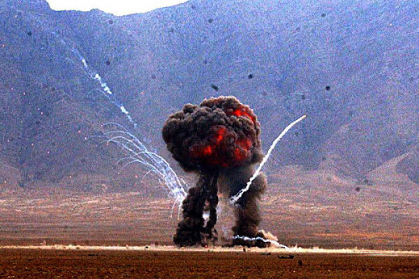A weapons cache is detonated at the East River Range on Bagram Airfield, Afghanistan, Dec. 2, 2004. The cache was destroyed by airmen of the U.S. Air Force's 455th Explosive Ordnance Group.