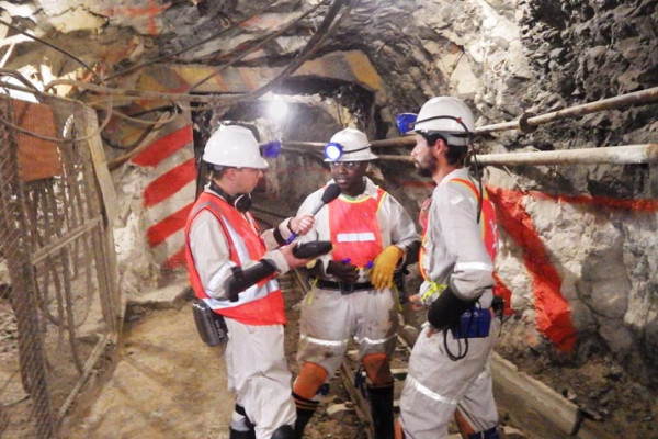 University of the Free State scientists Kay Kuloyo and Borja Linage with Chris Smith in the Sibanye Gold Dreifontein gold mine, South Africa.