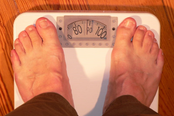 Weighing in... Using weighing scales to monitor your weight.