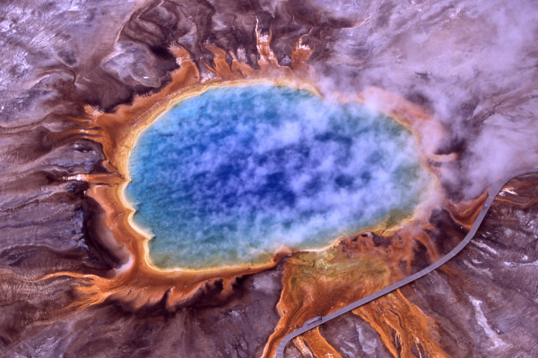 Aerial view of Grand Prismatic Spring; Hot Springs, Midway & Lower Geyser Basin, Yellowstone National Park. The spring is approximately 250 by 300 feet (75 by 91 m) in size.