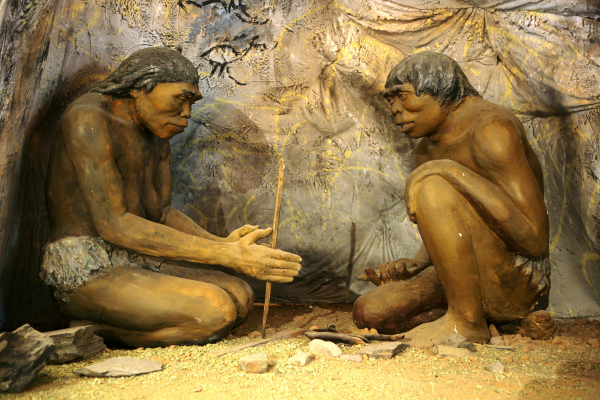 Homo erectus making fire for warmth and cooking