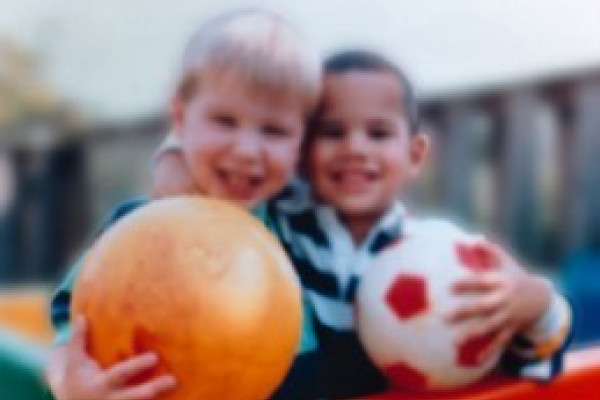 Human eyesight - two children and ball with myopia short-sightedness