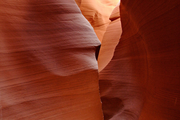 Inside Lower Antelope Canyon, featuring red sandstone corridors.