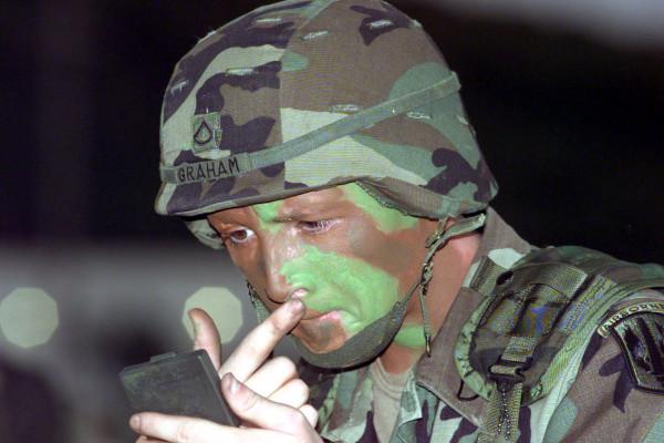 PFC Joel Graham puts on camouflage paint