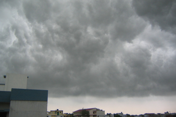 A photo of dark stormy monsoon clouds over the city of Lucknow,India.