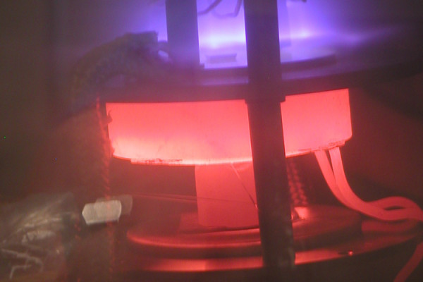 DC-PECVD system in action. DC plasma (violet) improves the growth conditions for carbon nanotubes in this chemical vapor deposition chamber. A heating element (red) provides the necessary substrate temperature.