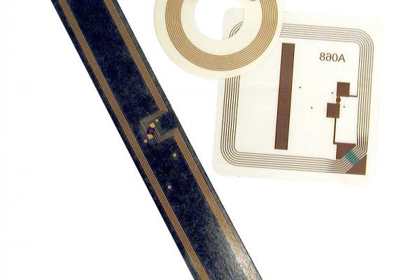 RFID tags used in libraries: square book tag, round CD/DVD tag and rectangular VHS tag