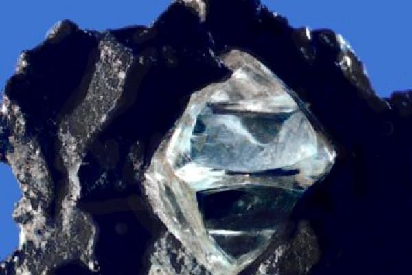 A slightly misshapen octahedral diamond crystal in matrix.