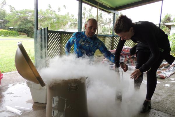 Josh Drew and Helen Scales preserving seagrass samples in liquid nitrogen in Fiji.