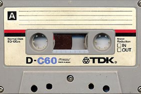 A TDK D-60 cassette, a common speech-quality tape with a 60-minute playing time, in a housing similar to that of the original Compact Cassette specification