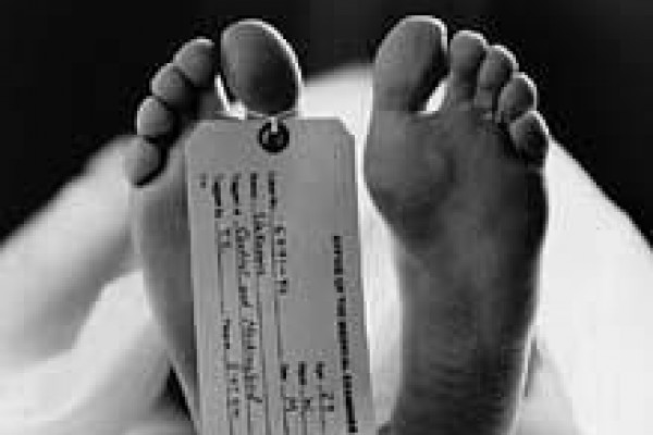 A toe tag is put on a toe of a dead body for identification reasons in morgues