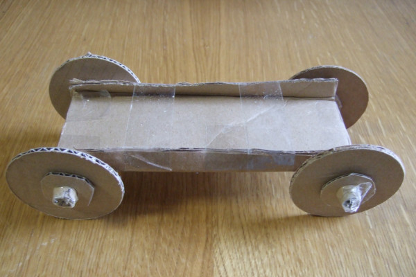 A car with a small axle made out of toilet roll cardboard