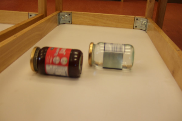 A race between jam and water filled jars