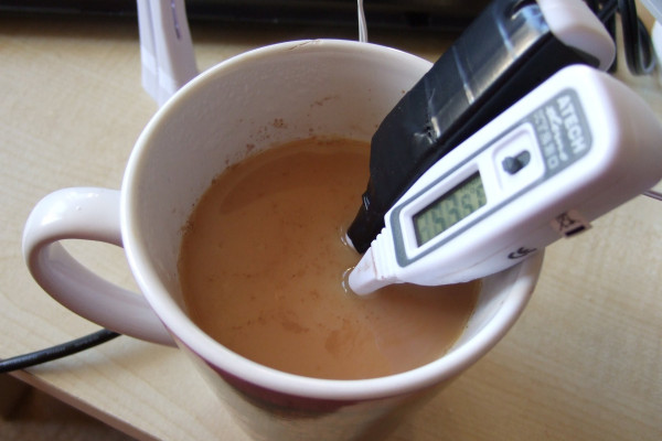 Measuring the temperature both with a normal thermometer and one connected to a computer.