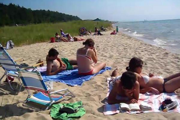 sun tanning on beach